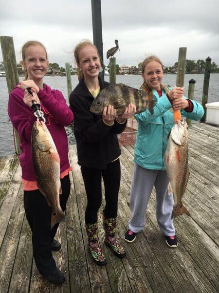 Girls Holding Redfish and Sheepshead