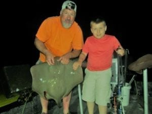 Father and Son Bowfishing