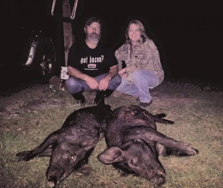Guests Participating in Nighttime Hog Hunting