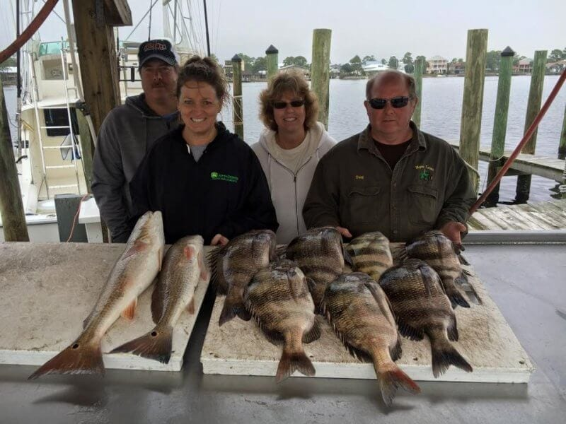 Group Showing Their Redfish and Sheepshead