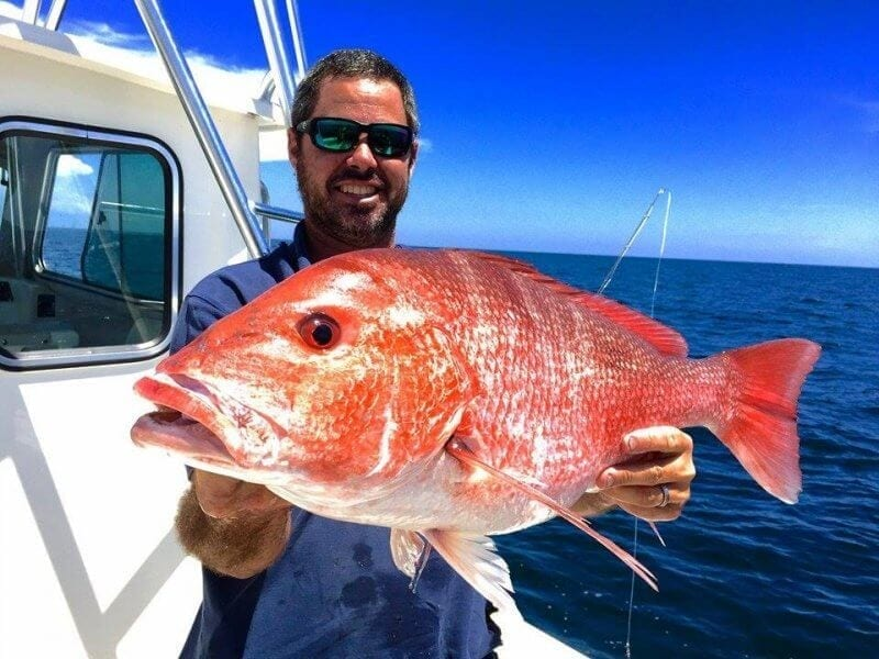 Guest With His Red Snapper Catch on Boat