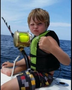 Young kid ready to catch his lifetime fish.