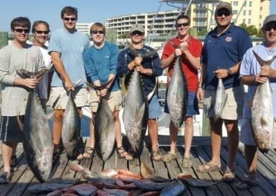 Bachelor Party Showing Their Tuna Catches