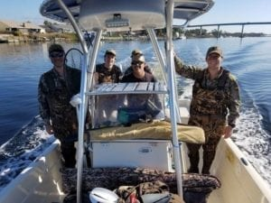 Guests traveling on a center console hunting boat to their hunting location