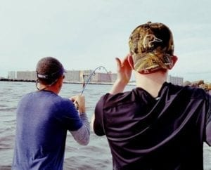 Men Learning Nearshore Fishing Techniques to Catch Redfish