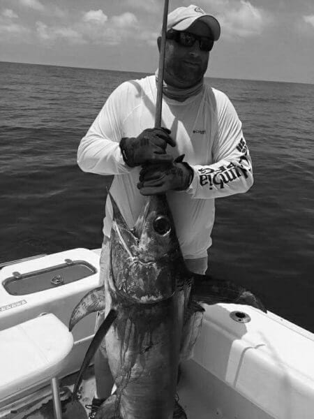 Guest Holding Swordfish in Black and White