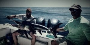 Men with Their Swordfish Catch