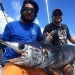 Men Displaying Trophy Swordfish