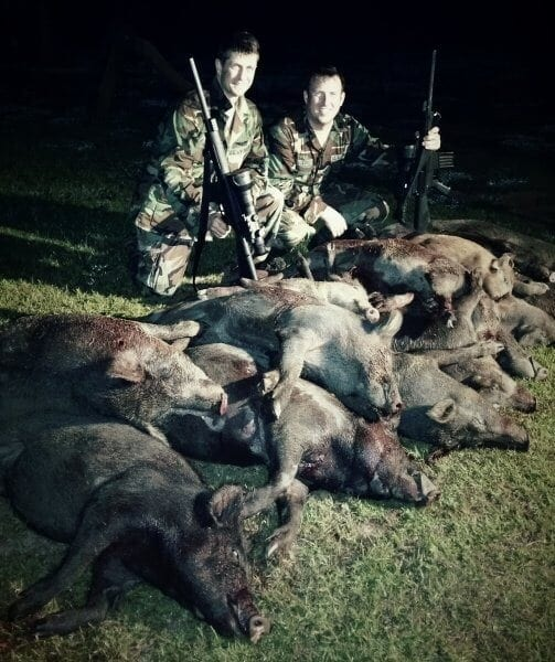 Guests with multiple ferrel pigs after their hog hunt