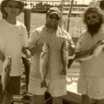 Stephen and Guests Holding Redfish Catches
