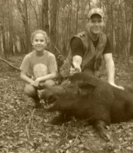 Father and Daughter with Wild Boar