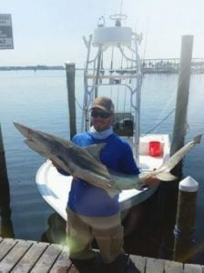 Guest Holding Thrasher Shark Caught Early Morning on Dock