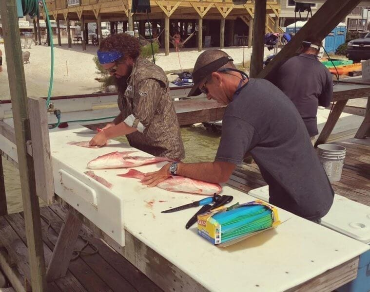 Stephen Cleaning Guests' Red Snapper