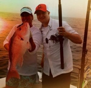 Mother and Son with Red Snapper