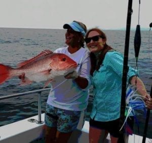 Women with Red Snapper Catch