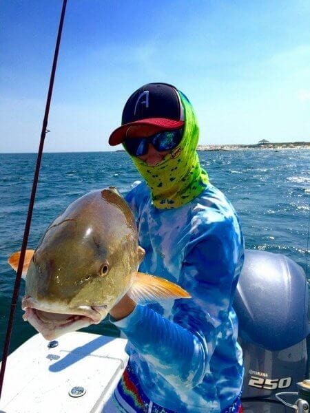 Guest Holding Bull Redfish on Boat