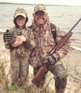 Father and son enjoying their duck hunt
